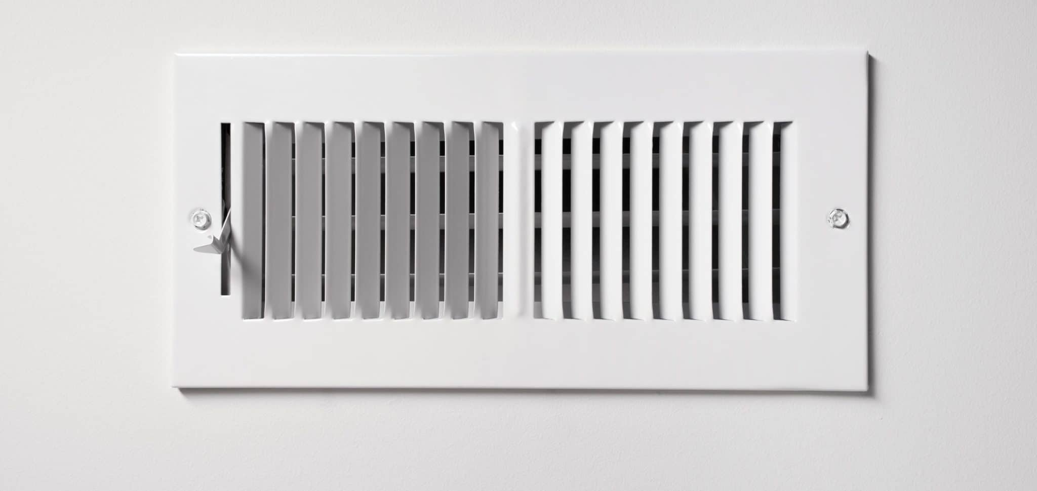 A heating cooling vent register on the wall of a home